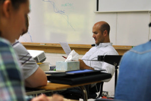 History teacher Chad Pirotte reads the Declaration of Independence along with his students.