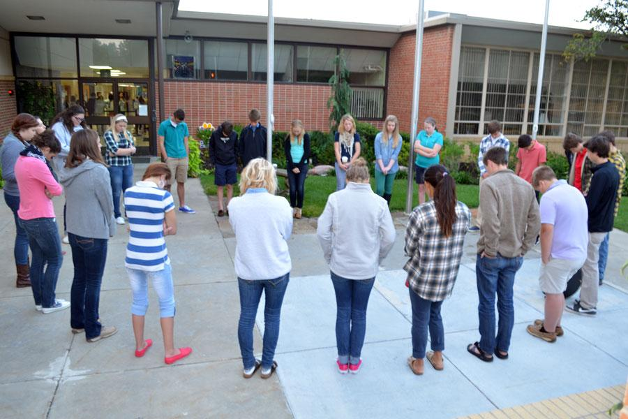 Students+bow+their+heads+in+prayer+at+annual+See+You+at+the+Pole.+