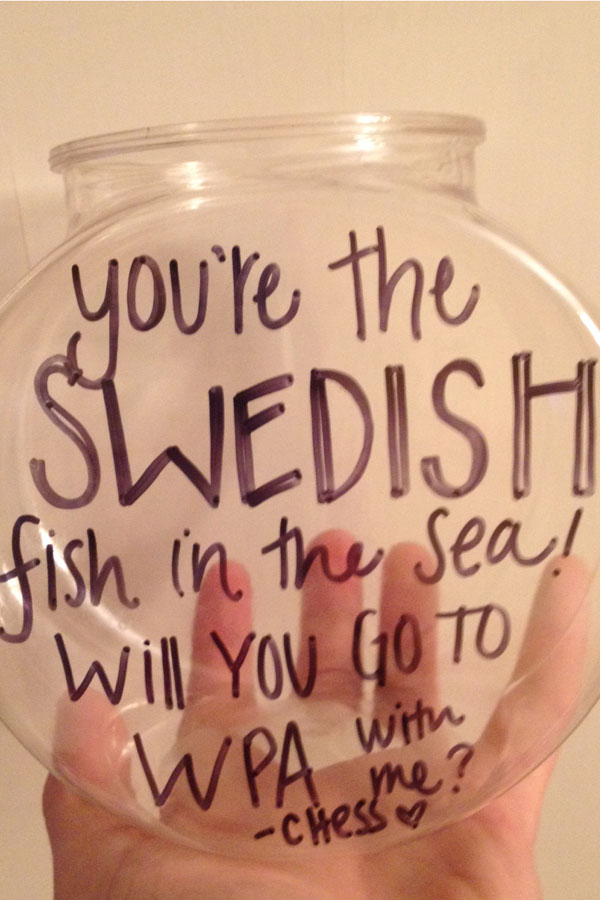 Senior Chessie Esposito asked senior Mitchell Pivovar with a plastic fishbowl filled with Swedish Fish.