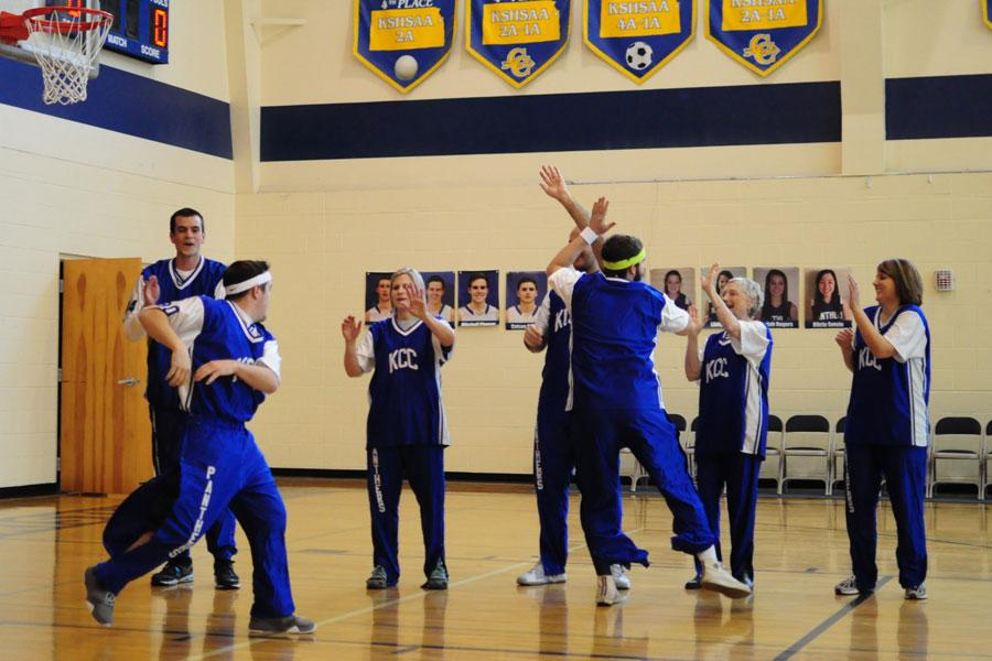The+teachers+playing+in+the+basketball+game+for+the+pep+rally+get+hyped+up+and+ready+to+play.