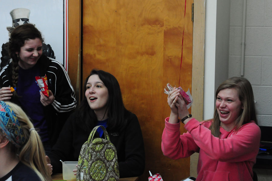 Seniors Michayla Kramer, Madeline McCully, and Sarah Birchler laugh together during lunch on Valentine's Day.