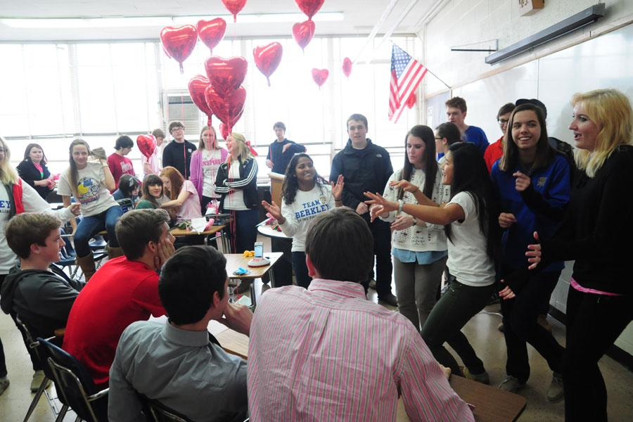The junior girls give a singing-gram to the junior boys at lunch.