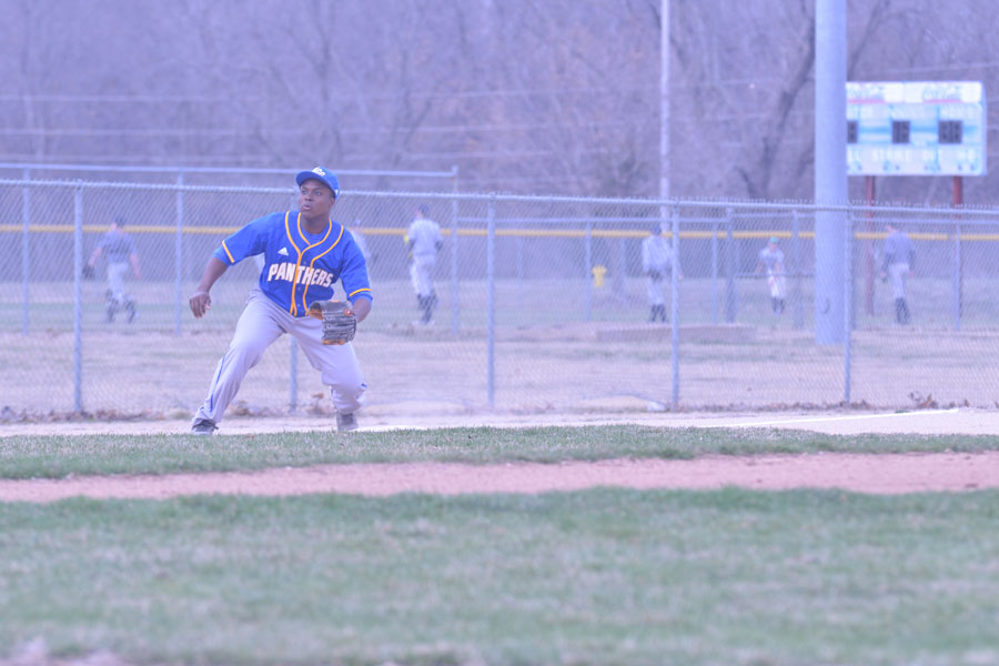 Junior Derrick Cook moves to catch a ball in the outfield.