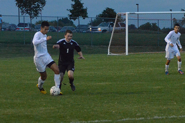 Competing for possession of the ball, sophomore Luke Kerley races against an opponent.