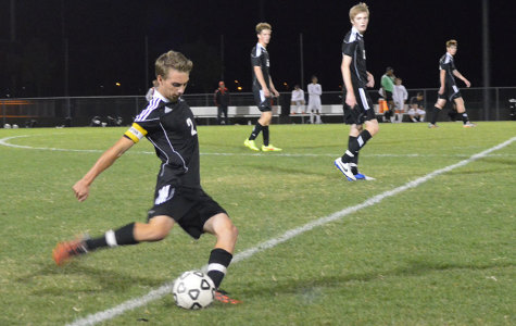 Approaching the ball, senior J.T. Trott gets ready to kick during the BV West game.
