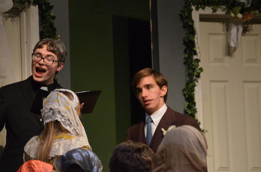 """During the ending scene of Friday's performance, senior Caleb Busch oversees a marriage ceremony between Lague and Dooley. After the curtain closed on the last night, senior Jake Fields said, """"I'm relieved play week is over and I can get a full night's sleep."""""""