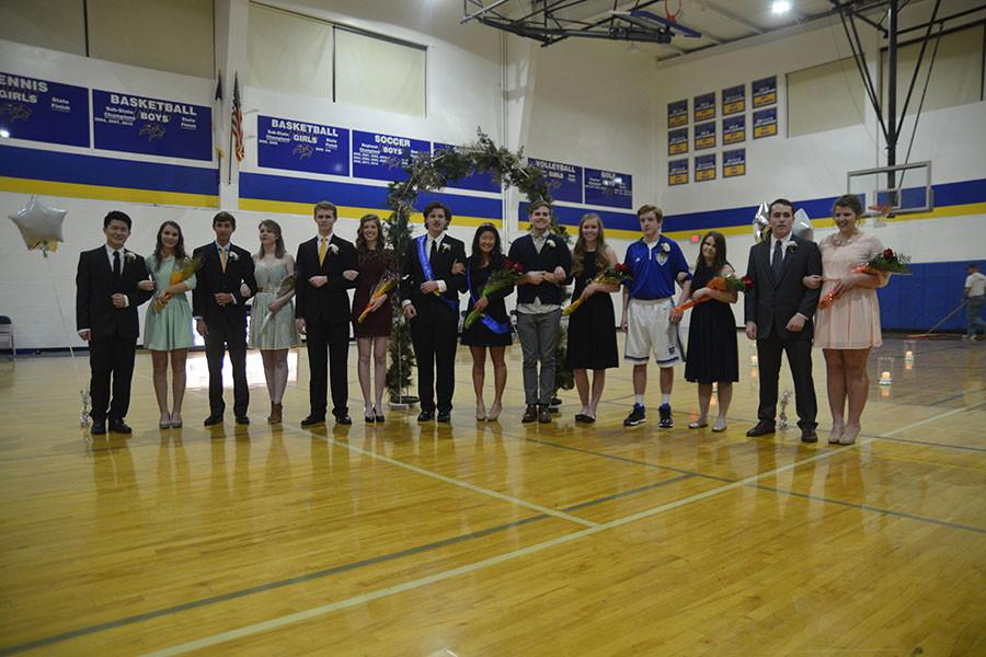 Homecoming candidates stand together and smile for pictures.