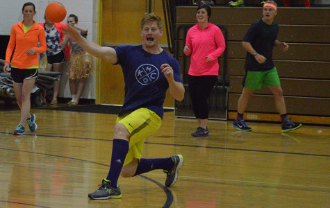 Substitute teacher Walter Elder hurls the ball at another player. His team went on to win the tournament.