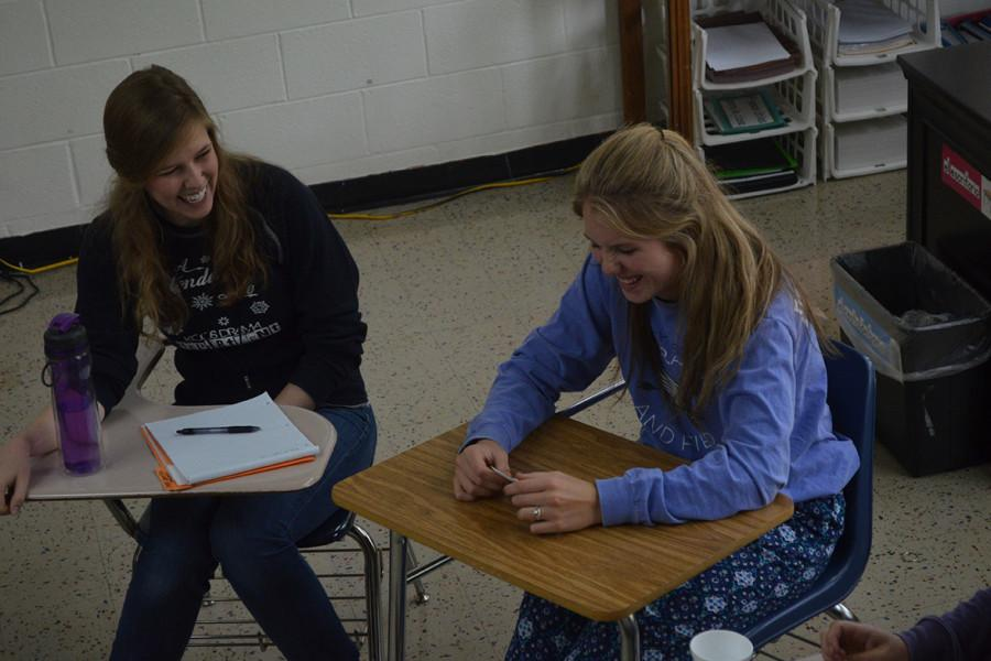 Spanish teacher Paige Patton and junior Paige Hardt laugh. Patton is the Spiritual Formation Group leader for the year.