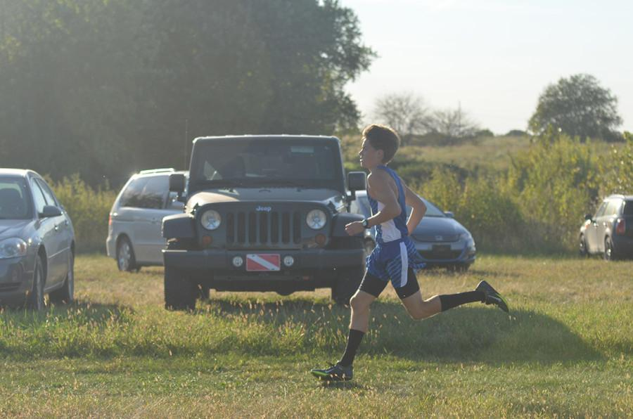 Junior Luke Rovenstine runs hard as he makes his way across Zarda Farm.