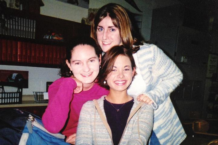 Bible teacher Cayli Pankratz smiling at school with her good friends during her senior year in high school.
