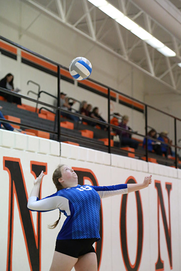 Photo courtesy of Richard Hardt. Senior Kaitlyn Burns serves to the opposing team in the Sub-State game against Lyndon.