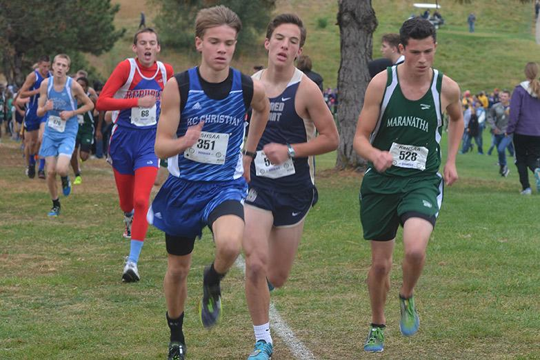 Junior Luke Rovenstine races against his opponents.