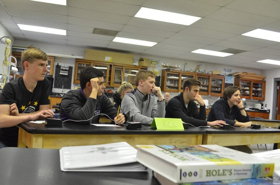 The+scholars+bowl+team+waits+in+anticipation+for+the+next+question.
