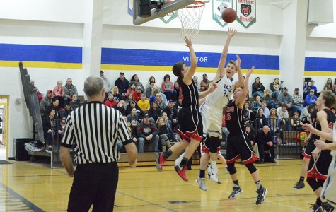 Junior Davis Gunnigle shoots the ball in hopes of scoring a point.