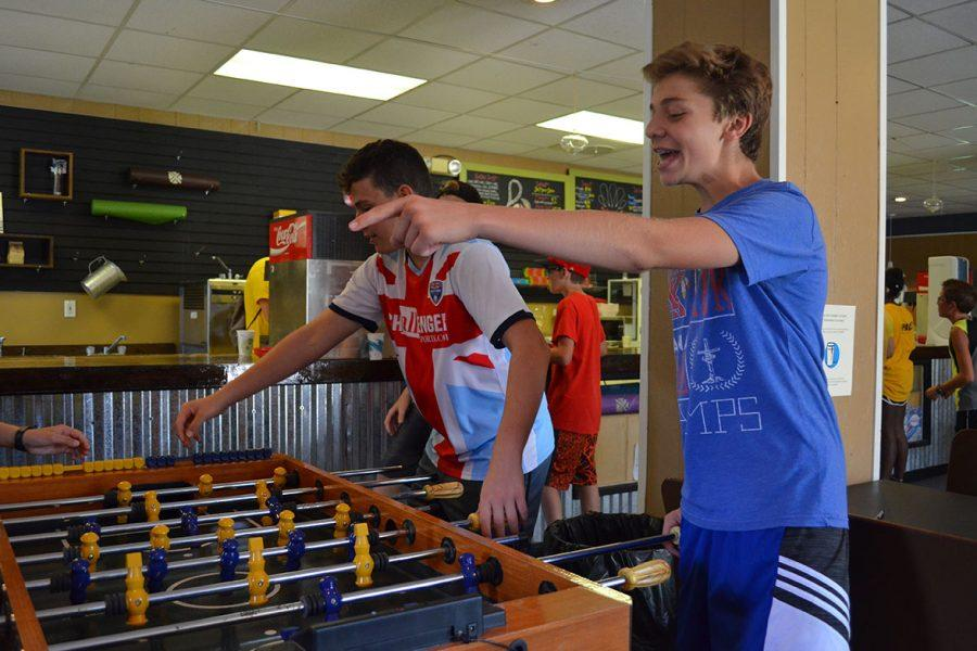 Eighth grader Logan Carnes gets intense while playing foosball in the snack shop.