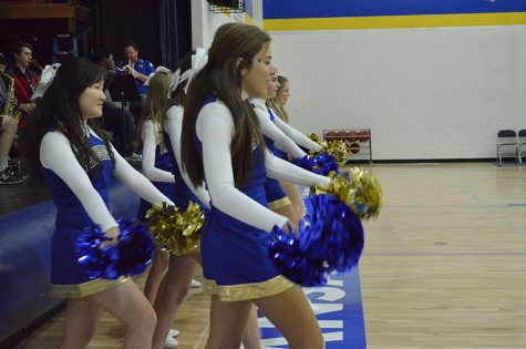 Juniors Abby Swafford and Helen Sun cheer on the boys during their scrimmage with the rest of the cheer squad.