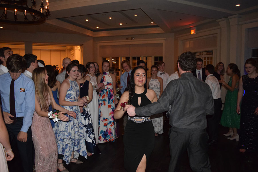 Juniors Elise Gamble and Josh Kucera swing dance in the middle of the dance floor.
