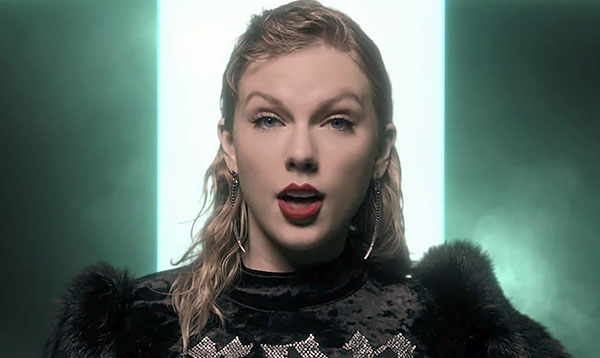 Taylor Swift sings in her new music video,
