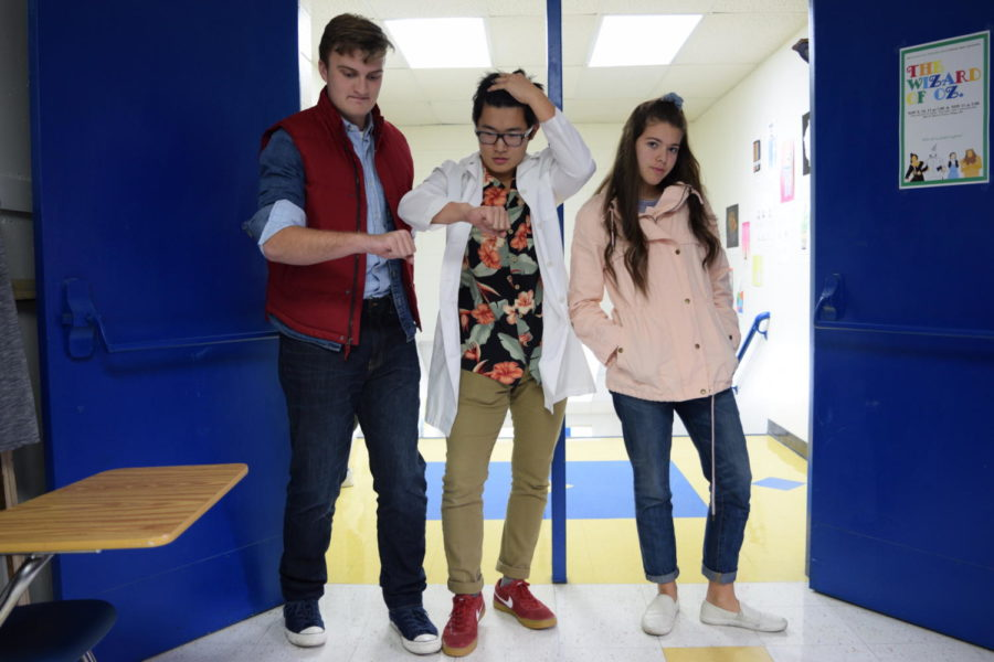 Seniors Ian Ko, Nolen Wright, and Abby Swafford show off their Halloween costumes