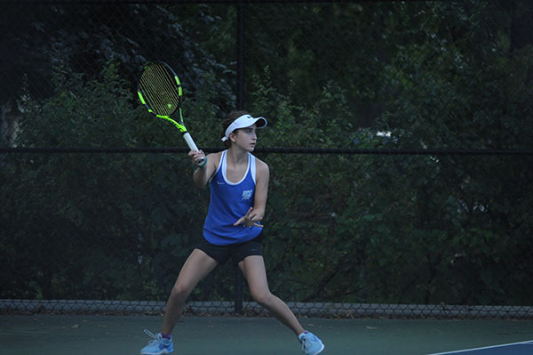 Knoflicek winds up for a swing during a match.